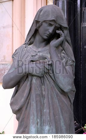 ZAGREB, CROATIA - OCTOBER 10: Mourning sculpture on a Mirogoj cemetery in Zagreb, Croatia on October 10, 2015.