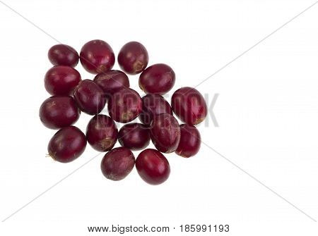 Red and ripe coffee beans isolated on a white background