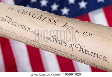 Declaration of independence with United States flag in background
