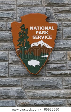 April 4 2017: National Park Service Sign on Stone Wall Vertical outside a visitor center