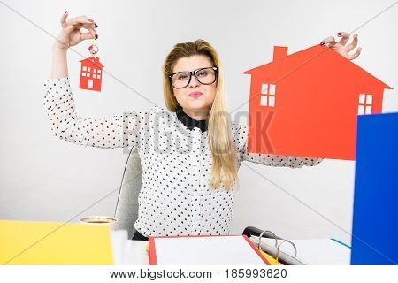 Thining Business Woman In Office Holding House