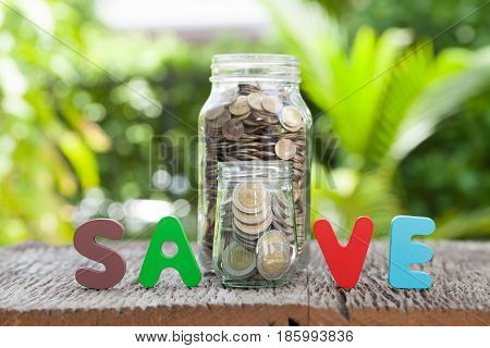 money in the glass Save money for investment concept
