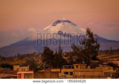 The amazing sunset view of Cotopaxi volcano from Latacunga town, Ecuador