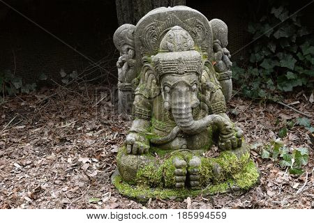 Ancient oriental Ganesha statue made of stone