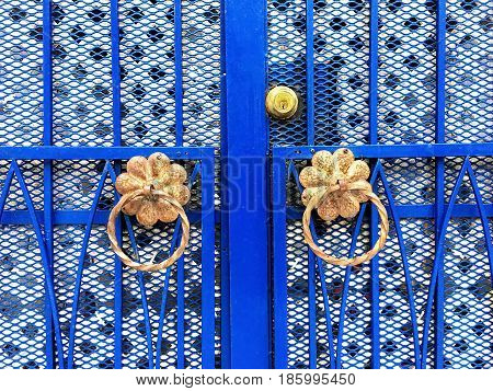 Blue iron gate with ornamental details. Montreal Quebec Canada.