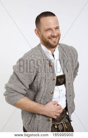 An image of a man in bavarian traditional outfit for Oktoberfest