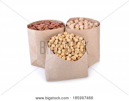 dry soy bean garbanzo and pinto bean in paper bag and on white background