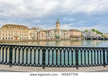 Beautiful view of historic city center of Zurich with famous Fraumunster Church and Munsterbucke crossing river Limmat Canton of Zurich, Switzerland