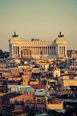 Rome rooftop view with Monumento Nazionale a Vittorio Emanuele II in Italy at sunset.  poster
