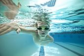 underwater shot of boy swimming laps in pool poster