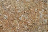 Fragment of brown rustic weathered stone surface poster