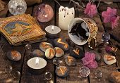 Mystic still life with coffee grounds, tarot cards and stone runes. Halloween background, coffee reading ritual, occult and esoteric objects on witch table poster