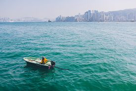 Hong Kong China - January 01 2014: Dinghy Boat in Victoria Harbour beside Avenue of Stars