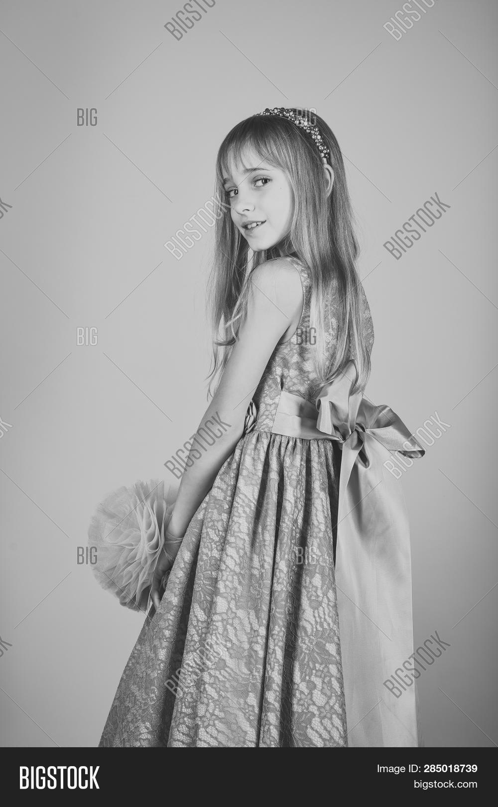 86c569d6f79f Little girl in fashionable dress, prom. Fashion and beauty, little princess.  Fashion model on pink background, beauty. Child girl in stylish glamour  dress, ...
