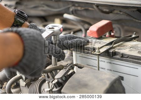 Mechanic, Technician Man Check The Car Engine In Garage. Car Service, Repair, Fixing, Checking Maint