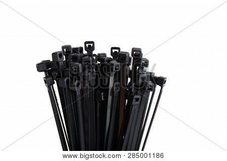 A Bundle Of Bleck Cable Ties, Isolated On White