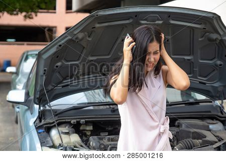 Young Woman Having Trouble With Broken Car Feeling Stressed And Crazy, Opening Hood And Calling For