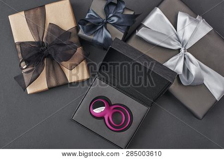 Special Gift For Her...pink Clitoris Vibrator For Women And Couples In A Black Box Laying Against Bl