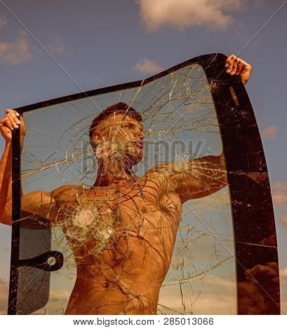 Youthful Ambition. Strong Man Hold Cracked Glass. Sport Man With Muscular Strength. Sport Training.
