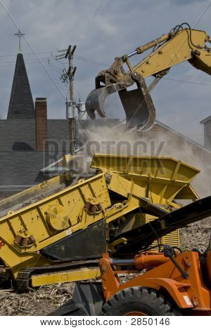 Construction Site With Rubble Being Put Into A Dump Truck