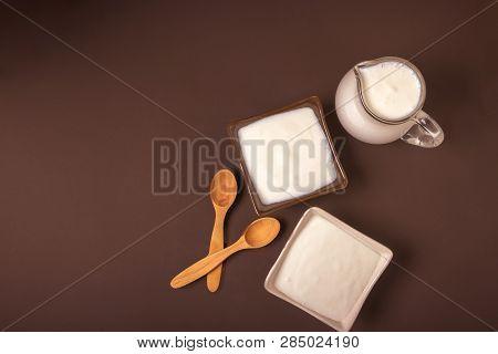 Homemade Yogurt In Ceramic Square Bowls, A Jug Brim Full Of Yogurt Behind The Bowls. Healthy Food Fr