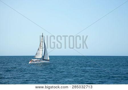 Sailboat Sailing On The Sea. Ship Sailing In Full Sails On The Sea. Yacht In The Sea.