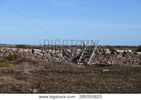 Old Wooden Stile By A Footpath In A Great Plain Grassland At The Swedish Island Oland