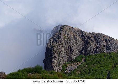 Dense Clouds On The Pico Do Arieiro Mountain. Portuguese Island Of Madeira