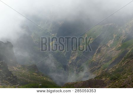 Green Canyon In A Fog. View From Pico Do Arieiro On Portuguese Island Of Madeira