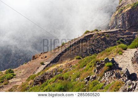 Narrow Hiking Trails On The Mountain Pico Do Arieiro. Portuguese Island Of Madeira