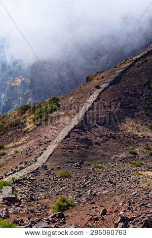 Narrow Hiking Trail In The Volcanic Terrain. Pico Do Arieiro On Portuguese Island Of Madeira