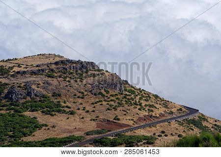 Empty Mountain Road Against Dense Clouds On Pico Do Arieiro. Portuguese Island Of Madeira
