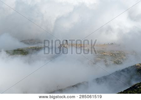 Abandoned House On The Mountain Peak Wrapped In The Clouds. Scenery From Pico Do Arieiro On Portugue