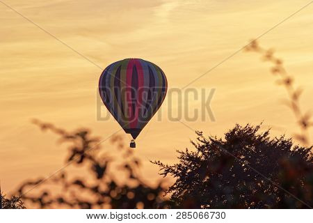 Colorful Hot Air Balloon Against Sky At Sunset. Hamburg, Germany