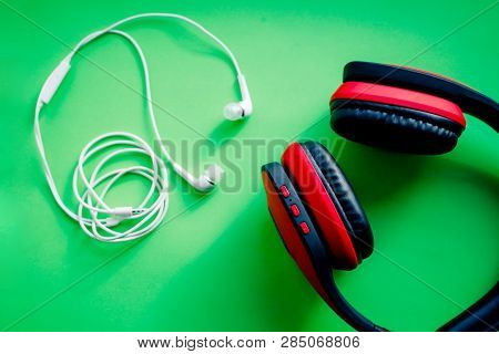 Wireless Over-ear Full Size Headphones, Black And Red Leather Isolated On Green Background With Clip