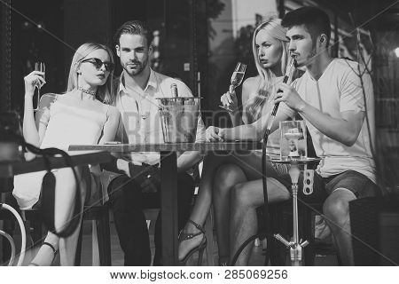 Celebration, Party Concept. Friends Vapor Hookah And Drink Alcohol In Bar Lounge. Addiction, Bad Hab