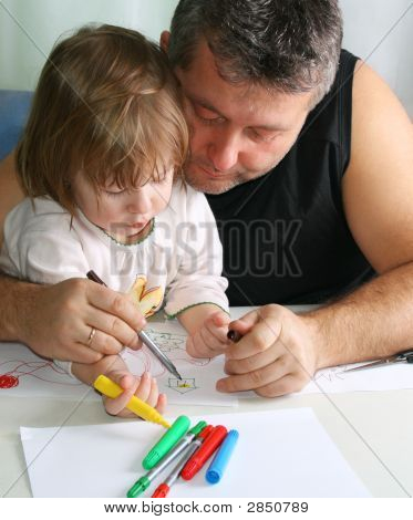 Cute little girl and father drawing with soft-tip pen poster