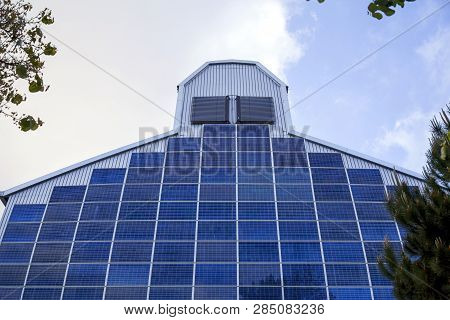 Renewable, Alternative Solar Energy, Photocell - Solar Panels On The Wall Of The Building. In Front