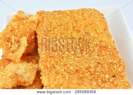 Sheet Crisp Rice Breads Snack Corn Flakes With Sesame On Plate Isolated On White Background