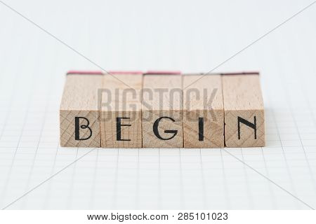 Begin, Debut, Company Establish Or Start Own Business Concept, Wooden Stamp With Alphabet Building T