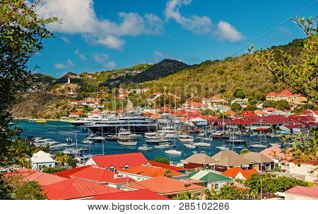 Gustavia, St.barts - January 25, 2016: Yacht Club Or Port With Ships And Boats On Tropical Harbor. Y