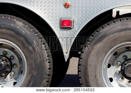 Industrial Truck Trailer Axle Tires And Wheels In Sunlight