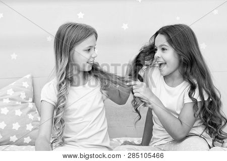 Strong Hair. Children Cheerful Play With Hair In Bedroom. Happy Childhood Moments. Kids Girls Sister