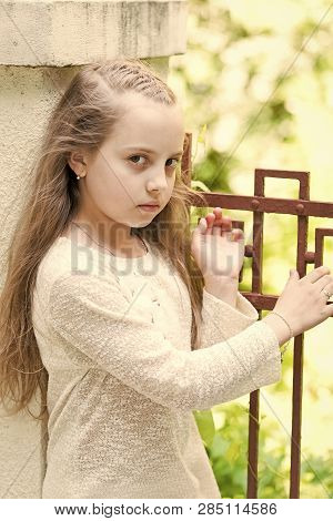 Girl With Long Hair On Calm Face, Urban Background. Kid Girl Long Hair Looks Cute And Tender, Close