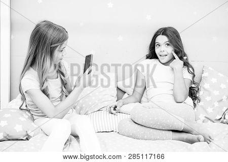 Kids Taking Photo Shooting Video. Smartphone Photo Concept. Girlish Leisure Pajama Party. Girls Smar
