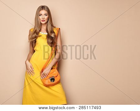 Portrait Of Fashion Young Woman In Yellow Dress. Female Model In Stylish Spring Summer Outfit. Girl
