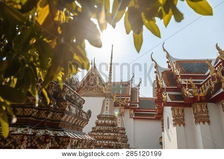 Beautiful Buddhist Temple Wat Pho In The Capital Of Thailand Bangkok Against The Blue Sky, Bright Co