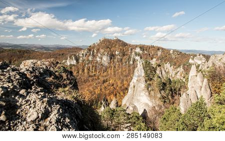 Autumn Sulovske Skaly Mountains In Slovakia With Colorful Forest, Rocks And Blue Sky With Few Clouds