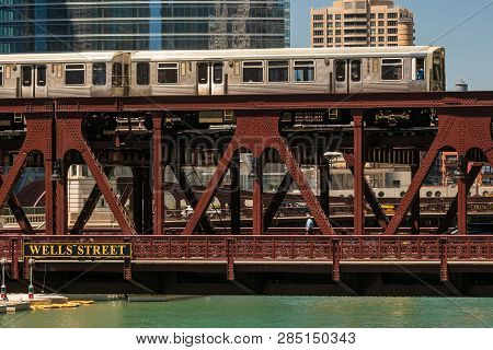 Train In Downtown Chicago And A Vintage Steel Bridge