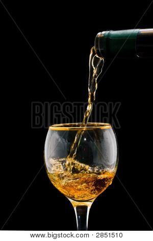 Jet of gold wine current in a glass poster